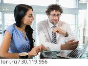 Купить «Businessman discussing with colleague over laptop», фото № 30119956, снято 12 апреля 2016 г. (c) Wavebreak Media / Фотобанк Лори