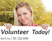 Купить «Smiling woman holding billboard against forest background», фото № 30122696, снято 23 ноября 2016 г. (c) Wavebreak Media / Фотобанк Лори