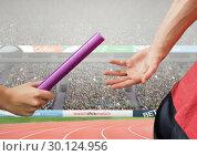 Купить «Athlete passing baton during relay race against stadium in background», фото № 30124956, снято 8 декабря 2016 г. (c) Wavebreak Media / Фотобанк Лори