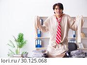 Купить «Crazy young man in straitjacket at the office», фото № 30125068, снято 30 ноября 2018 г. (c) Elnur / Фотобанк Лори
