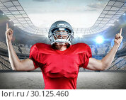 Купить «Digitally generated image of american football player cheering with clenched fist», фото № 30125460, снято 8 декабря 2016 г. (c) Wavebreak Media / Фотобанк Лори
