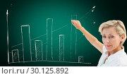Купить «Female executive pointing towards upward graph», фото № 30125892, снято 16 декабря 2016 г. (c) Wavebreak Media / Фотобанк Лори