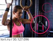 Купить «Determined woman practicing gymnastic exercise», фото № 30127096, снято 23 декабря 2016 г. (c) Wavebreak Media / Фотобанк Лори