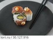 Купить «Sushi served on plate with chopsticks», фото № 30127916, снято 8 декабря 2016 г. (c) Wavebreak Media / Фотобанк Лори
