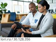 Купить «Businessman and a colleague discussing over digital tablet», фото № 30128356, снято 16 октября 2016 г. (c) Wavebreak Media / Фотобанк Лори