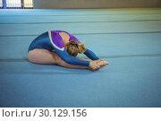 Купить «Female gymnast performing stretching exercise», фото № 30129156, снято 14 сентября 2016 г. (c) Wavebreak Media / Фотобанк Лори