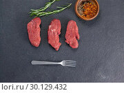 Купить «Beef steak, rosemary herb and spices», фото № 30129432, снято 20 сентября 2016 г. (c) Wavebreak Media / Фотобанк Лори