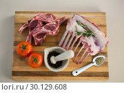 Купить «Rib rack, rib chop and ingredients on wooden board», фото № 30129608, снято 20 сентября 2016 г. (c) Wavebreak Media / Фотобанк Лори