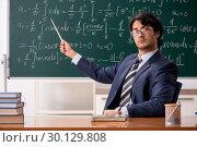 Купить «Young male math teacher in classroom», фото № 30129808, снято 11 октября 2018 г. (c) Elnur / Фотобанк Лори
