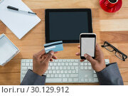 Businessman doing online shopping on mobile phone. Стоковое фото, агентство Wavebreak Media / Фотобанк Лори