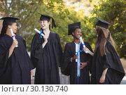 Купить «Graduate school kids standing with degree scroll in campus at school», фото № 30130740, снято 19 ноября 2016 г. (c) Wavebreak Media / Фотобанк Лори