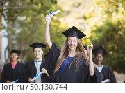 Купить «Graduate school kids standing with degree scroll in campus», фото № 30130744, снято 19 ноября 2016 г. (c) Wavebreak Media / Фотобанк Лори