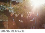 Купить «Successful graduate school kids throwing mortarboard in air in campus», фото № 30130748, снято 19 ноября 2016 г. (c) Wavebreak Media / Фотобанк Лори