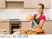 Купить «Young female baker working in kitchen», фото № 30130764, снято 1 ноября 2018 г. (c) Elnur / Фотобанк Лори