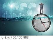 Купить «Businessman in deadline and time management concept», фото № 30130888, снято 19 марта 2019 г. (c) Elnur / Фотобанк Лори