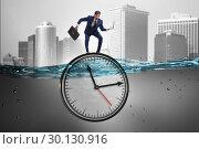Купить «Businessman in deadline and time management concept», фото № 30130916, снято 19 марта 2019 г. (c) Elnur / Фотобанк Лори
