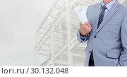 Купить «Businessman holding blueprints against construction site in background», фото № 30132048, снято 25 января 2017 г. (c) Wavebreak Media / Фотобанк Лори