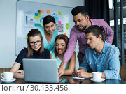 Купить «Businesspeople having discussion over laptop in office», фото № 30133456, снято 15 октября 2016 г. (c) Wavebreak Media / Фотобанк Лори