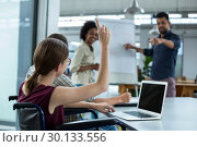 Купить «Business executives discussing over flip chart during meeting», фото № 30133556, снято 15 октября 2016 г. (c) Wavebreak Media / Фотобанк Лори