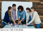 Купить «Business team discussing over digital tablet in meeting», фото № 30133656, снято 15 октября 2016 г. (c) Wavebreak Media / Фотобанк Лори