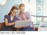 Купить «Business executives discussing over laptop», фото № 30134056, снято 27 ноября 2016 г. (c) Wavebreak Media / Фотобанк Лори