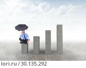 Купить «Businessman seating with an umbrella on graph against grey background», фото № 30135292, снято 6 февраля 2017 г. (c) Wavebreak Media / Фотобанк Лори