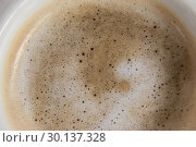 White coffee cup with creamy froth. Стоковое фото, агентство Wavebreak Media / Фотобанк Лори