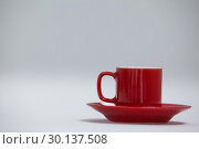 Купить «Close-up red coffee cup and saucer», фото № 30137508, снято 6 октября 2016 г. (c) Wavebreak Media / Фотобанк Лори