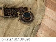 Купить «Black coffee with scoop and sack textile», фото № 30138020, снято 6 октября 2016 г. (c) Wavebreak Media / Фотобанк Лори