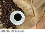 Купить «Black coffee, roasted beans and scoop on sack», фото № 30138028, снято 6 октября 2016 г. (c) Wavebreak Media / Фотобанк Лори