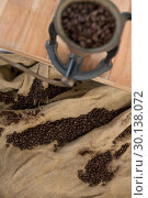 Купить «Coffee beans on sack textile with coffee grinder», фото № 30138072, снято 6 октября 2016 г. (c) Wavebreak Media / Фотобанк Лори