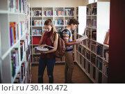 Купить «Attentive classmates reading book in library», фото № 30140472, снято 19 ноября 2016 г. (c) Wavebreak Media / Фотобанк Лори