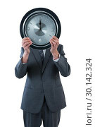 Купить «Businessman holding a clock in front of his face», фото № 30142324, снято 24 августа 2016 г. (c) Wavebreak Media / Фотобанк Лори