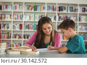 Купить «School kids doing homework in library at school», фото № 30142572, снято 20 ноября 2016 г. (c) Wavebreak Media / Фотобанк Лори