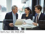 Купить «Business people discussing over laptop », фото № 30143956, снято 19 ноября 2016 г. (c) Wavebreak Media / Фотобанк Лори