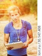 Купить «Portrait of female trainer holding clipboard during obstacle course», фото № 30147408, снято 24 ноября 2016 г. (c) Wavebreak Media / Фотобанк Лори