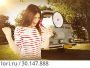 Composite image of excited young woman shouting with megaphone . Стоковое фото, агентство Wavebreak Media / Фотобанк Лори