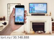 Купить «Composite image of cropped image of hand holding smart phone», фото № 30148888, снято 8 июня 2017 г. (c) Wavebreak Media / Фотобанк Лори