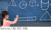 Купить «Girl drawing on blackboard with school geometry drawings», фото № 30151196, снято 24 июля 2017 г. (c) Wavebreak Media / Фотобанк Лори