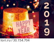 Купить «Happy New Year Golden hat on a table», фото № 30154704, снято 1 октября 2018 г. (c) Wavebreak Media / Фотобанк Лори