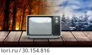 Купить «Autumn and Winter seasonal weather transition landscape with wood surface and television», фото № 30154816, снято 1 октября 2018 г. (c) Wavebreak Media / Фотобанк Лори