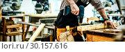 Купить «Carpenter working on his craft», фото № 30157616, снято 15 ноября 2018 г. (c) Wavebreak Media / Фотобанк Лори