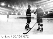 Купить «Composite image of ice hockey players shaking hands at rink», фото № 30157672, снято 15 ноября 2018 г. (c) Wavebreak Media / Фотобанк Лори