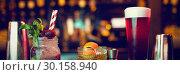 Купить «Bar accessories with cocktails on counter», фото № 30158940, снято 4 января 2019 г. (c) Wavebreak Media / Фотобанк Лори