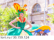 "Купить «Russia Samara August 2018: Portrait of a girl on stilts in a festive floral costume at the ""Flower Festival"" procession», фото № 30159124, снято 25 августа 2018 г. (c) Акиньшин Владимир / Фотобанк Лори"