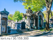 Купить «A view of the Pere Lachaise, the most famous cemetery of Paris, France, with the tombs of very famous people», фото № 30159300, снято 9 сентября 2018 г. (c) Николай Коржов / Фотобанк Лори