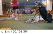 Купить «Playing mini golf. A young woman playing mini golf indoors», видеоролик № 30159564, снято 25 марта 2019 г. (c) Константин Шишкин / Фотобанк Лори