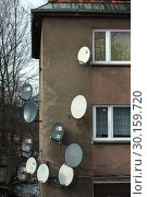 Купить «Poland, Bytom (Bytom) - Parabolic antennas on a house wall», фото № 30159720, снято 28 февраля 2018 г. (c) Caro Photoagency / Фотобанк Лори
