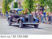 Купить «Russia Samara August 2018: The famous Soviet retro car GAZ-M-1 is driving along a city street.», фото № 30159940, снято 25 августа 2018 г. (c) Акиньшин Владимир / Фотобанк Лори