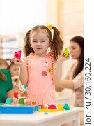 Купить «Child playing with blocks in kindergarten», фото № 30160224, снято 21 февраля 2019 г. (c) Оксана Кузьмина / Фотобанк Лори